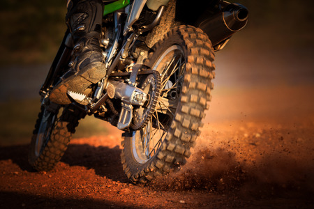 off road biking: action of enduro motorcycle on dirt track