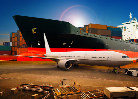 air freight: air freight ,cargo plane loading trading goods in airport container parking lot use for shipping and air transport logistic industry against shipping port background Stock Photo