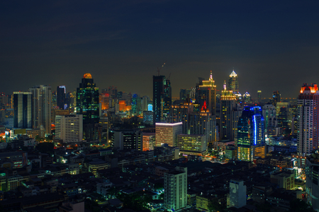 office building: city scape in heart of bangkok thailand with beautiful lighting of office building and sky scrapper against dusky sky twilight time Stock Photo
