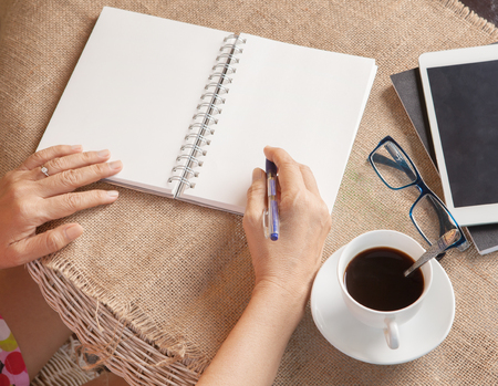 write: woman writing shot memories note on white paper with relaxing time and emotion