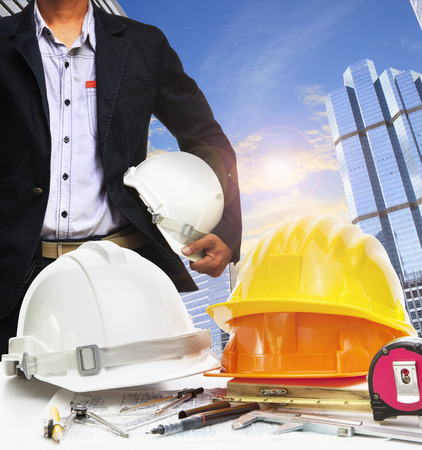 land use: engineer working table against sky scrapper in urban scene use for land development and architecture occupation theme