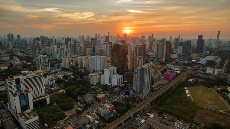 infra construction: aerial view unseen skyscraper in heart of bangkok thailand capital sun set time