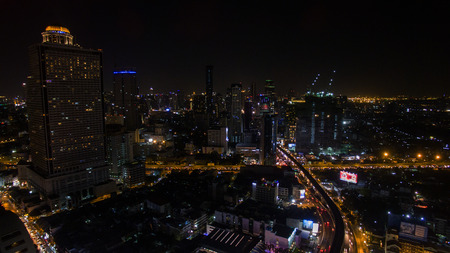 infra construction: aerial view of bangkok night scene silom - sathorn landmark