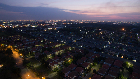 land management: aerial view at dusk of home village in bangkok thailand use for land management and real estate ,residence cummunity Stock Photo