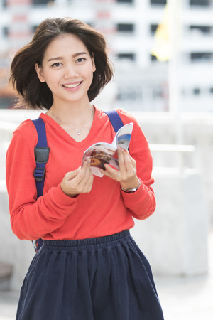 beautiful young woman: attractive young asian student traveling outdoor smiling face with happiness emotion Stock Photo