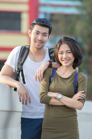 couples of younger asian man and woman relaxing with happy face on vacation trip