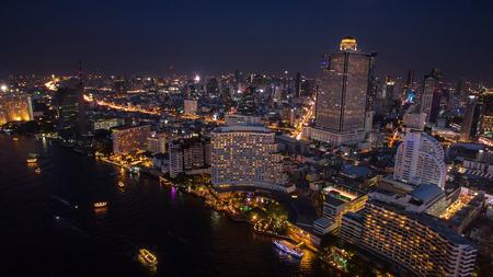sky scraper: aerial night scene of bangkok sky scraper beside chaopraya river thailand capital