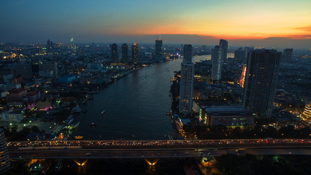 above: aerial view of bangkok sky scraper over chaopraya river in beautiful dusky time Stock Photo