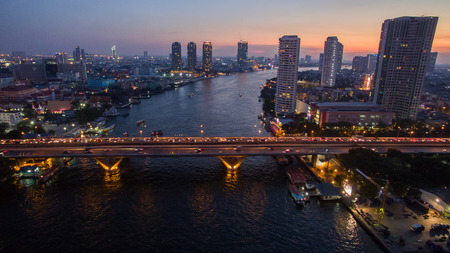 river scape: aerial view of beautiful dusky time chaopraya river and takson bridge important landmark in heart of bangkok thailand capitabl Stock Photo