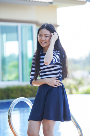 female model: portrait of young asian teen smiling face happiness emotion at home