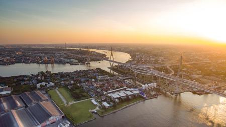 land transportation: aerial view of bhumibol 1,2 bridge important landmark of bangkok thailand capital in land transportation crossing chaopraya river