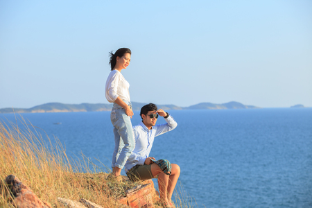 younger: portrait of asian younger man and woman relaxing vacation at sea side happiness emotion Stock Photo