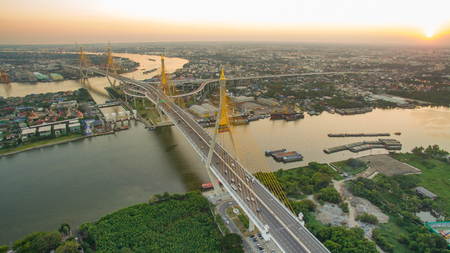 river scape: aerial view of bhumibol 1,2 bridge important landmark of bangkok thailand capital in land transportation crossing chaopraya river