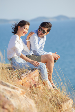 portrait of asian younger man and woman relaxing vacation at sea side happiness emotion Stock fotó
