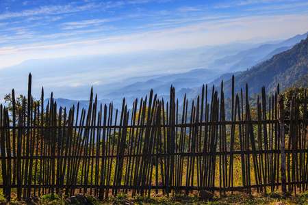 land scape: bamboo fence in rural field with beautiful natural mountain land scape wide angle view point
