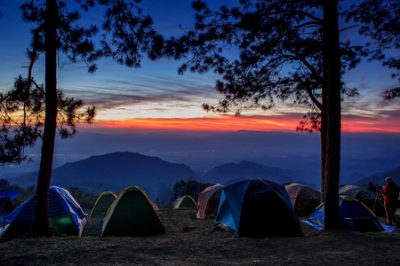 sun rising: beautiful landscape and sun rising sky with traveling  camping tent field in angkhang -phahompok national park chiangmai northern of thailand