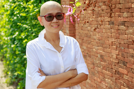 bald head: portrait self confidence asian woman with bald head after cancer chemical medicine treatment course