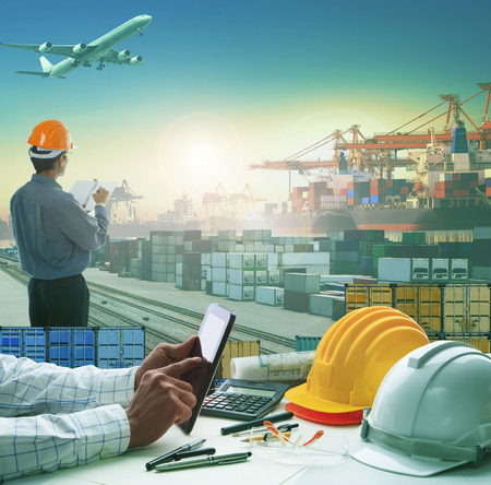 hand of business man working on working table in container dock use for logistic industry and import export , freight cargo shipping industrial Imagens - 51751363