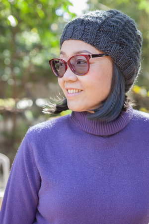 old asian: thai asian woman 40s years old wearing purple winter clothes and wool hood. Stock Photo