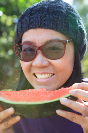close up face: close up face of woman eating watermelon Stock Photo