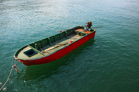 clear water: single boat floating on clear water Stock Photo