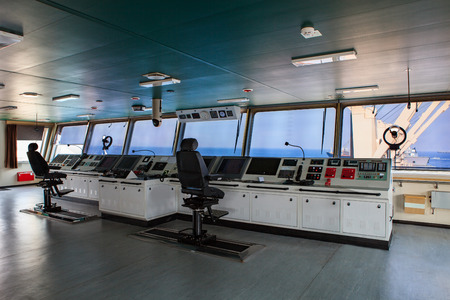 wheelhouse control board of modern industry ship approaching to harbor Editoriali