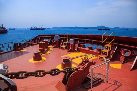 tanker ship: working field on front of heavey commercial tanker ship floating over blue ocean harbor