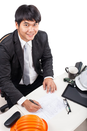 drawing table: architect man working on drawing table smiling with happiny face isolated white background Stock Photo