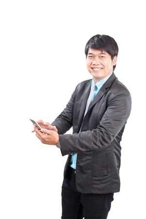 younger: younger business man toothy smiling face with happiness emotion touching on smart phone screen isolated white background Stock Photo