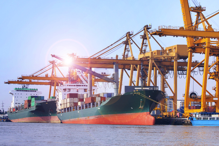 construction equipment: commercial ship loading container in shipping port image use for import ,export nautical vessel transport and industry logistic
