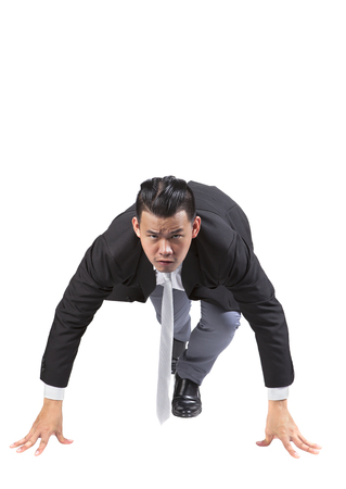 acting: asian business man acting like runner athlete in start patform isolated white background use for speed ,competition abstract meaning