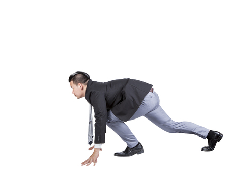 asian business man: asian business man acting like runner athlete in start patform isolated white background use for speed ,competition abstract meaning