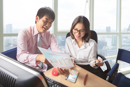 younger man: younger man and woman meeting in office working table scene for people business lifestyle