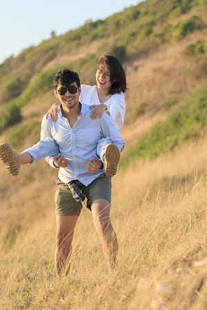younger: couples younger asian man and woman relaxing time on vacation destination traveling