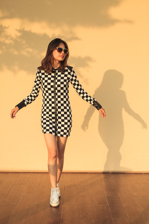 fashion dress: portrait of asian teen wearing sun glasses and fashion short dress with beautiful posting