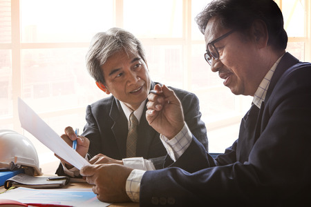 planing: couples of senior partner business man meeting with serious problem solution planing crisis decision in office meeting room Stock Photo