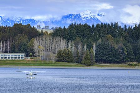 te: water plane floating over fresh water lake against beautiful mountain scenery in lake te anau new zealand