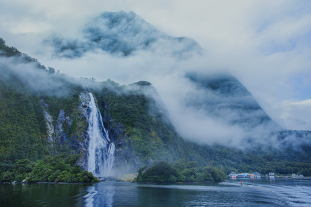 newzealand: water falls in milford sound important traveling destination in fiordland national park south island new zealand