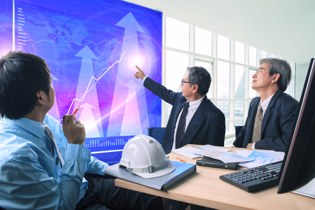 group of business man meeting with business graph in office meeting room Stock Photo