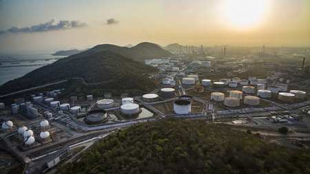 tube top: aerial view of oil tank storage in heavy petrochemical industries estate plant