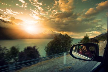 newzealand: photographer taking a photo on the way to beautiful destination Stock Photo