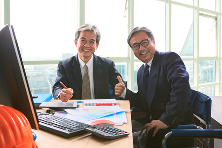 mature business man: good healthy of couples friendship senior working man shot on office working table, happiness emotion ,laughing face