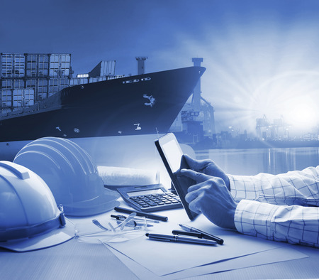 oversea: hand of working man in shipping ,logistic freigh cargo transport business blue theme