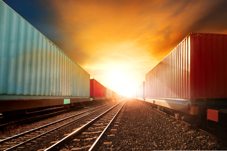 land transport: industry container trainst running on railways track against beautiful sun set sky use for land transport and logistic business