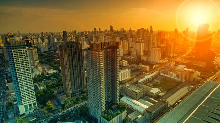 sky scraper: aerial view of sky scraper in heart of bangkok thailand capital with beautiful sun light over sky
