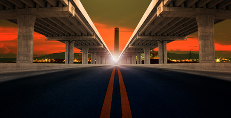 tollway: perspective on bridge ram construction and asphalt raod isolated white background use for infra structure and night scene of industry estate background
