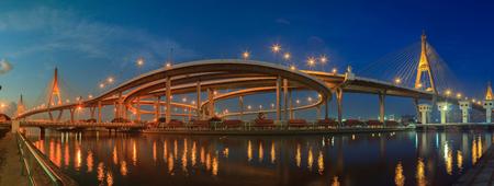 infra construction: panorama view of bhumiphol bridge important landmark and transport,traffic construction bridge crossing chaopraya river in bangkok thailand capital Stock Photo