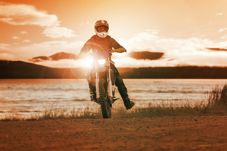 motorcross: man riding enduro motorcycle in motor cross track use for people activities and leisure ,traveling extreme motor sport