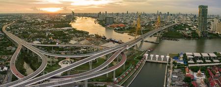 samutprakarn: aerial view of bhumiphol bridge crossing chaopraya river important landmark and traffic and land transportation in bangkok thailand