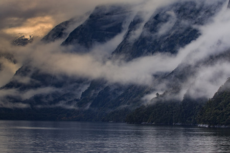 foggy: foggy mountain scene in milfordsound fiordland national park soutn island new zealand important traveling desination